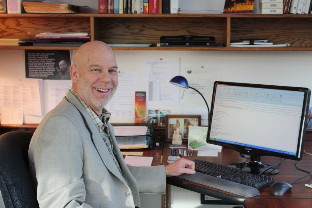 CityU Faculty Member Michael Theisen working at his desk