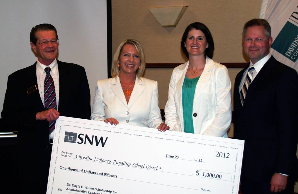 Christine Moloney receiving the 12th Annual Dr. Doyle Winter Scholarship
