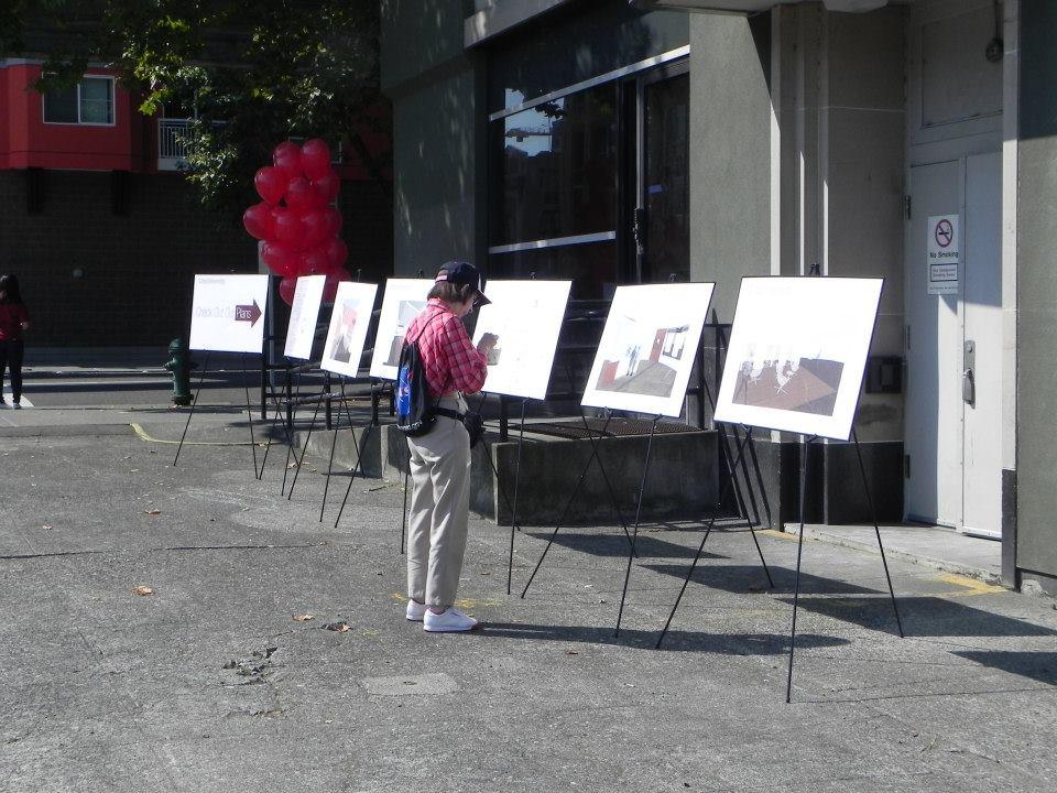 A Neighbor looking at CityU's building plans at Food for Thought