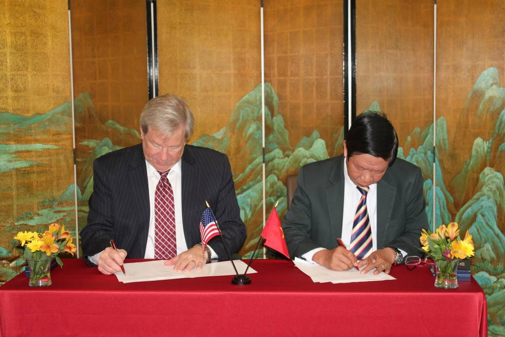 CityU Provost, Dr. Steve Olswang, signing the agreement with HCMC University of Education
