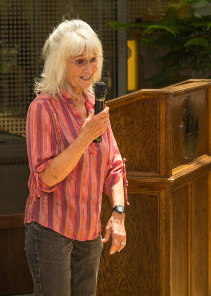 Dr Rita Kepner with microphone