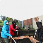 Three students gardening in cold weather
