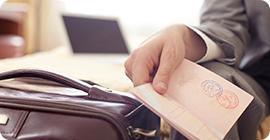 hand holding open passport