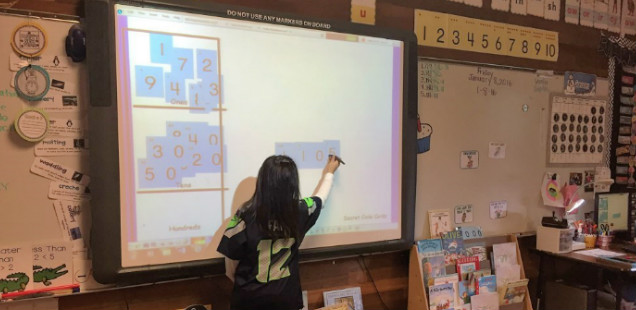 Sonja Vaughan's students use a smartboard
