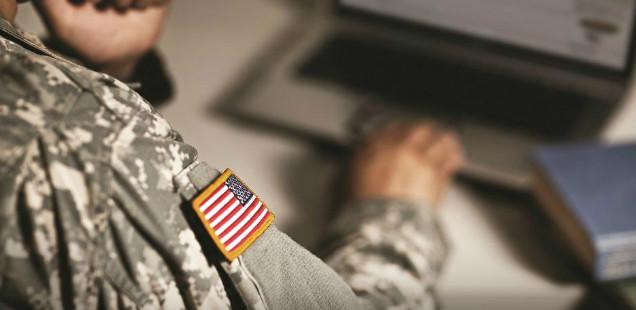 Military member at computer