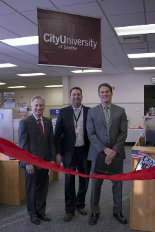 Randy Fisch, Matt Hanusa and Vice President of Academics and Kurt Kirstein at the ribbon cutting for the new City University of Seattle site at Joint Base Lewis-McChord
