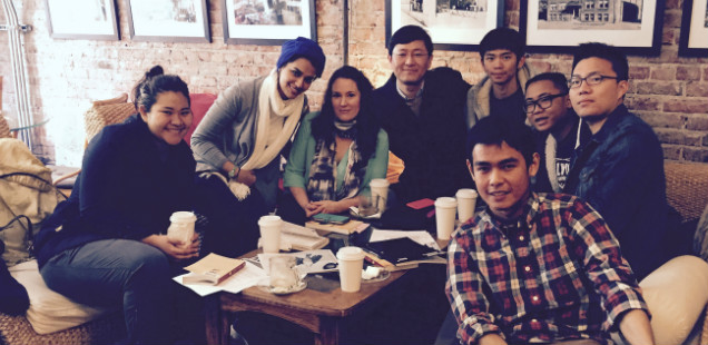 Students and teacher in an English class in a coffee shop