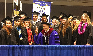 NU's Northern California graduates celebrate with Chancellor Cunningham.