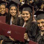 CityU Graduates holding diplomas