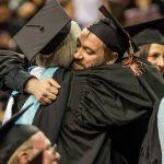 CityU Graduates hugging