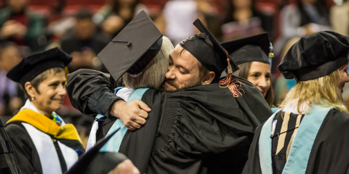 CityU Graduates hugging each other