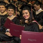 CityU Graduates smiling with diplomas
