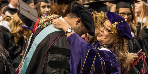 CityU Graduates Receiving diplomas