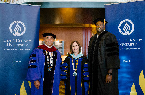 Former Golden State Warrior and JFKU alumnus Adonal Foyle receives an honorary doctorate from Chancellor Cunningham and JFKU President Debra Bean.
