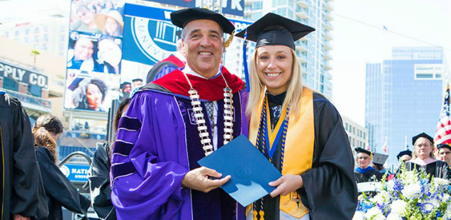 Chancellor Cunningham with his daughter Tressa Cunningham, who earned a master's degree at NU.