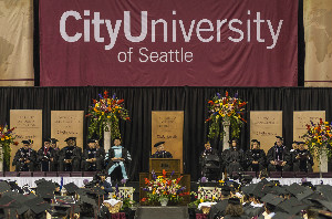 CityU President Randy Frisch addresses graduates at the Key Arena on June 17.