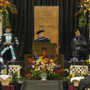 President Frisch looks out at graduates