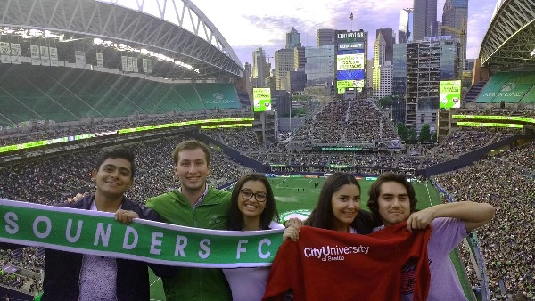 Summer in Seattle students attend a Seattle Sounders FC match.