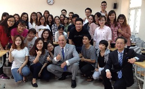 Chancellor Cunningham meets with students at one of the System's international education partners in Vietnam.