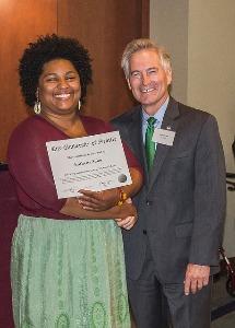 President Frisch recognizes a Dean's List honoree.