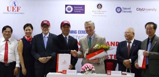 President Frisch and BOT member Hiep Quach further CityU's global reach in Hanoi.