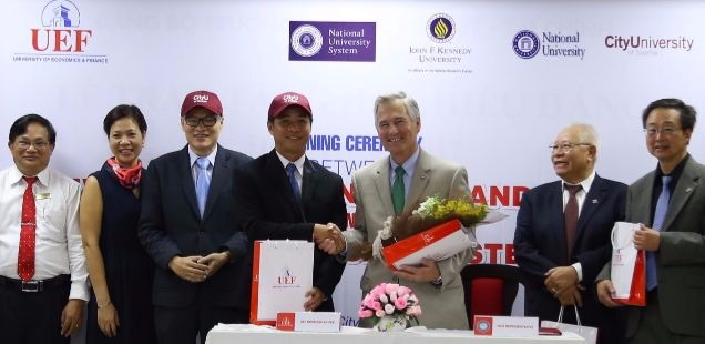 President Frisch and BOT member Hiep Quach further CityU's global reach in Hanoi.