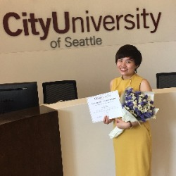 Kay Le with graduation certificate at CityU