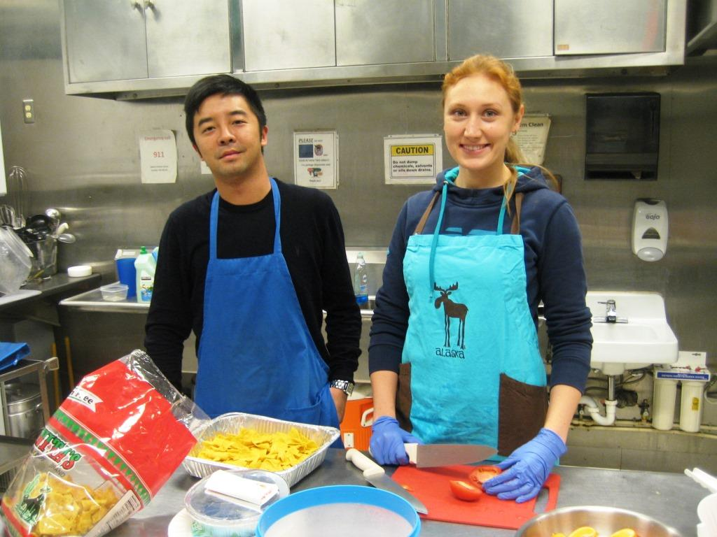 IMG_3637 -Jan. 5- J & N help get everything ready for the students' lunch -which starts in less than 1 hour! -comprsd,adj
