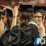 Graduates Holding Tassle
