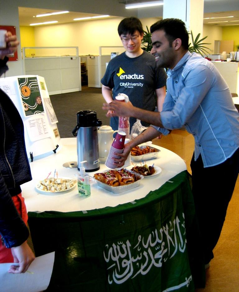 Abdullah serves coffee and tea to other students.