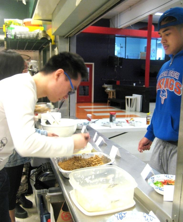 Photo of student serving food.